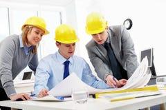 Three architects Royalty Free Stock Image