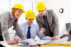 Three architects Stock Images
