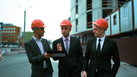 Three architects discuss newly constructed building stock footage