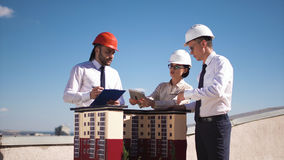 Three architects or engineers having a meeting royalty free stock photo