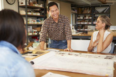 Three Architects Sitting Around Table Having Meeting Stock Photography