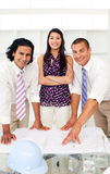 Three architects studying a plan stock image