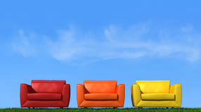Three armchair on grass Stock Images