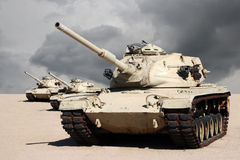 Three Army War Tanks in Desert. Three American army war tanks lined up in the dry hot desert
