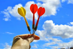 Three arrows darts in hand Royalty Free Stock Photo