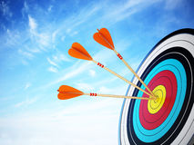 Three arrows hit at the center of the target. 3D illustration Stock Photo