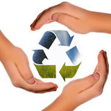 Three arrows of nature elements, recycling symbol. With hands Royalty Free Stock Images