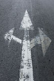 Three arrows sign on asphalt road Stock Photos