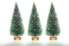 Three artificial Christmas trees Stock Photography