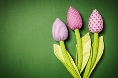 Three artificial tulips on the background Stock Image