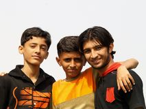 Three Asian brothers. A portrait of three Asian boys, all brothers as they pose together outside Stock Image