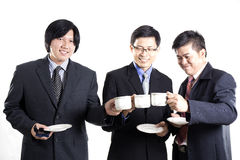 Three Asian business man with coffee break having conversation Royalty Free Stock Photography