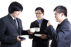 Three Asian business man with coffee break having conversation Royalty Free Stock Image
