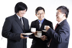 Three Asian business man with coffee break having conversation Stock Photo