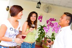Three Asian friends socializing Stock Image