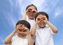 Three asian kids watching Stock Photography