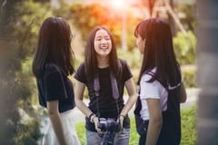 Three asian teenager  with dslr camera in hand pose as fashion model royalty free stock images