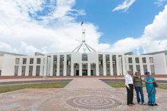 Three Asian tourists outside Australian Parliament House in Canb Stock Photo
