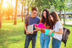 Three Asian young campus people tutoring and preparing for final. Examination in university. Education and learning concept. Friendship and Relation ship royalty free stock photography