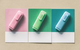 Three Assorted-color Markers stock images
