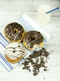 Three Assorted Donuts With Milk Royalty Free Stock Images