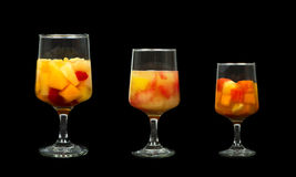Three Assorted Fruit Cocktails. Isolated on Black Background. Cherry Mixed Fruit Citrus Fruit, and Tropical Fruit royalty free stock images