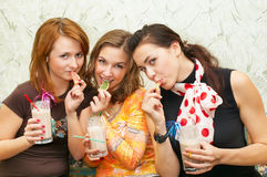 Three attractive girl eating fruit candies Stock Image