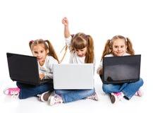 Three attractive girl using a laptop Stock Photos