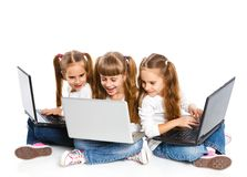 Three attractive girl using a laptop Stock Photography
