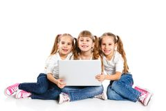 Three attractive girl using a laptop Royalty Free Stock Photography