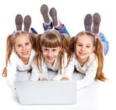Three attractive girl using a laptop Stock Images