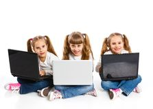 Three attractive girl using a laptop Royalty Free Stock Photo
