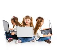 Three attractive girl using a laptop Royalty Free Stock Photos