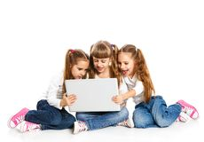 Three attractive girl using a laptop Stock Image