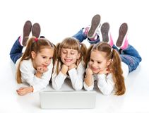 Three attractive girl using a laptop Royalty Free Stock Images