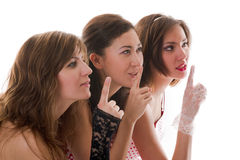 Three attractive girlfriends say royalty free stock photo