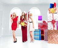 Three attractive girls with lots of gifts Stock Image