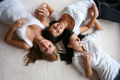 Three attractive girls on white Stock Image
