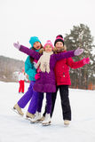 Three attractive skater girl hug on the ice Royalty Free Stock Image