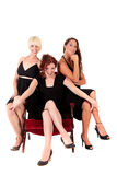 Three attractive women black dresses Royalty Free Stock Photos