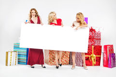 Three attractive women holding empty board Stock Photo