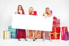 Three attractive women holding empty board Stock Photo