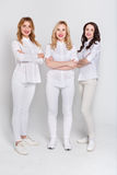 Three attractive women in white portrait on white background Royalty Free Stock Image