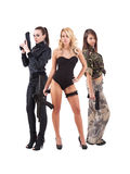 Three attractive young women with guns. Three attractive young women handing guns. Studio shot. White background royalty free stock photo