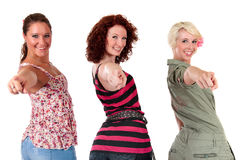 Three attractive young women pointing Royalty Free Stock Image
