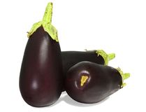 Three aubergine eggplants  on white. Background Royalty Free Stock Photography