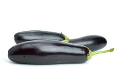 Three aubergines Stock Images