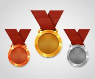 Three award medals with ribbons. Gold medal. Silver medal. Bronze medal. Championship award. Royalty Free Stock Images