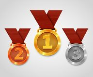 Three award medals with ribbons. Gold medal. Silver medal. Bronze medal. Championship award. Royalty Free Stock Photography