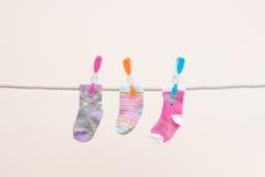 Three Babies Socks Royalty Free Stock Images